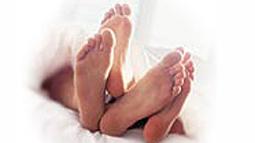 couple_bed_feet.jpg